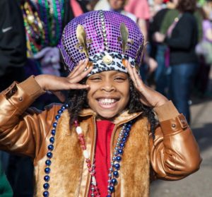 Child at Mardi Grad with Beeds. Photo by George Long
