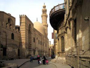 The striped Madrassa and Mausoleum of Barquq in the Bein al-Qasreen district of old Cairo, Egypt, dates from 1384. Courtesy of D-Stanley by Creative Comms License.