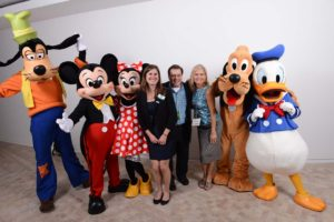 Hanging out at  the GM Test Track corporate lounge with the Fab 5. Pictured here: Goofy, Mickey Mouse, Minnie Mouse, Kristen Rocco (AIBTM), Rob Hard (Business Travel Destinations), Mary Haben (Convention South), Pluto and Donald Duck. June 10, 2014. Image courtesy of Disney Meetings.