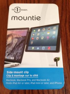 The Mountie is a side-mount clip that is black with green trim. It works with your Macbook laptops and other mobile Apple devices. And it will help streamline the way you work when traveling for business on the road. © Rob Hard 2015T