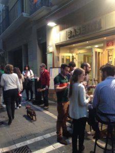 People Enjoying Pinchos at Bar Restaurante Baserri on San Nicolas in Pamplona